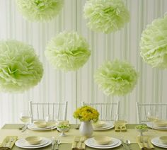 green tissue paper pom poms