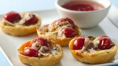 Need a tasty appetizer? Simple tomatoes, cheese and flaky pastry make a stunning nibble and addictive appetizer. tomato tartlet, flaki pastri, appetizers, recip, candi tomato, snack, tomatoes, brie, finger food