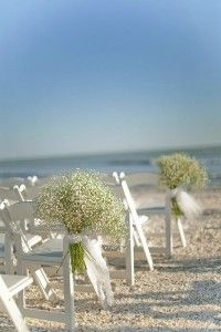 Baby's breath on the chairs and pews