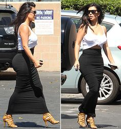 Is it getting hot in here? Kim K showed off her amazing curves in a white knotted tank top and a tight maxi skirt. She completed the look with a cute pair of peep-toe heels.