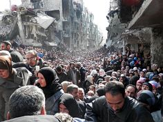 Yarmouk refugee camp in Syria. This was the queue for aid at a UNRWA distribution point in the capital, Damascus, on 31 January.