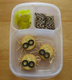 Glowing Pickle Cats, a Full Moon Brownie and Creamy Cheese Spider Crackers.