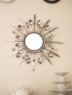 Repurpose old Silverware into starburst mirror -- or if you're really crafty make a clock!  Perfect for the kitchen or a funky dining room.  Plus there are tons of cheap silverware mismatched at thrift stores and yard sales.