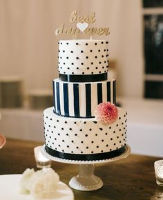 Polka dot and stripes wedding cake with an adorable cake topper #wedding #weddingcake #cake #polkadot #stripes