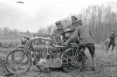 A Harley-Davidson motorcycle with a French Hotchkiss machine gun mounted on the sidecar.