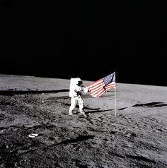 "November 19, 1969: Apollo 12 astronaut Charles ""Pete"" Conrad plants the U.S. flag on the lunar surface. Photo credit: NASA"