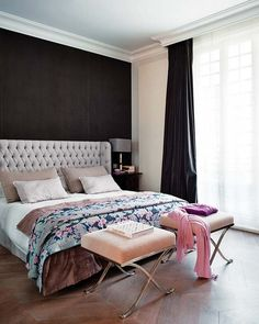 black accent wall + tufted headboard + palette in bedroom