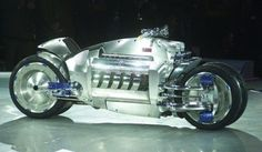Dodge Tomahawk V10 Superbike  for 700,000 USD. It's a 1,500-lb. bike with four wheels. Has a Dodge Viper's V-10 engine and can go from zero to 60 mph in 2.5 seconds, according to Edmunds.com. The top speed is estimated to be more than 300 mph. The bike, which made its debut at the 2003 North American International Auto Show in Detroit.