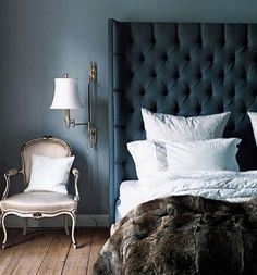 Blue bedroom, tufted heaboard, louis chair