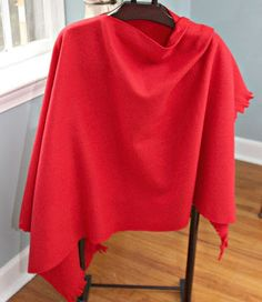No Sew Fleece Wrap ~    Use 1 1/2 yards of fleece.  Fold in half lengthwise.  Place a pin halfway up.  Cut along the fold up to the pin on one side.  Cut 2 inch long fringes on the short ends.  and that's it!  Here's how it looks and wraps.
