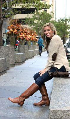 Cream sweater with elbow patches.  Skinny jeans. Knee high Brown leather boots.
