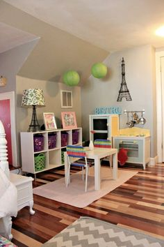 Shared girls bedroom big enough for ample play space for play kitchen and activity table.