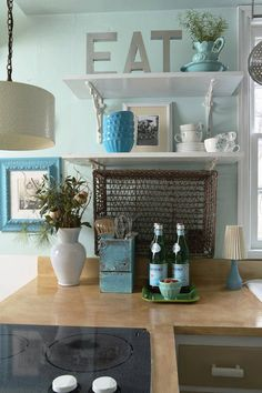 Great details in this kitchen. EAT sign, mini bowls from Anthropologie, ...