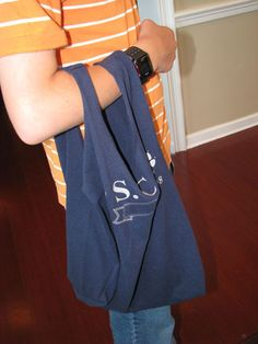 Hmmm, maybe a mess kit bag or just a project for the girls? No- sew T-Shirt bag