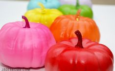 Love this idea for a colorful fall table or Halloween!