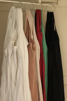 Tank top organization. Because who really needs a hanger for every single one. Use shower curtain hooks for easy on/off. shower curtain hook uses, top organ, diy shower curtain hooks, shower hooks, easi onoff, organize tank tops, tank top hanger, shower curtains, organizing tank tops