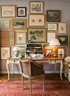 gallery wall with french desk. beautiful, muted colors!