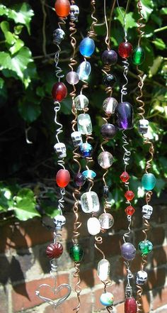 Beaded suncatchers - made & hanging in my window, turned out very pretty!    #DIY #beading #craft