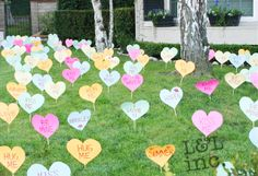 Two years ago the kids and I woke up to a fun surprise. My husband had brainstormed the idea to cut out several hearts, tape them to sticks and scatter them around the front lawn to wish us a Happy Valentines Day. It was a huge hit! The kids loved it and our house became quite the attraction that day for neighbors and others driving by.