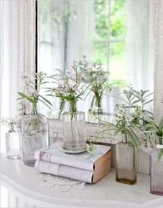 books, clear glass and sparse flowers make a clean display