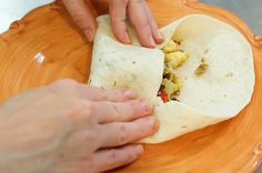 Breakfast Burritos to Go by Ree Drummond / The Pioneer Woman, via Flickr ~T~ I make these all of the time. I use turkey breakfast sausage, add more cheese , add diced green chilies, a can of black beans and some chipotle chili powder. I cook my eggs and then mix everything together.  I then roll them all up and freeze a bunch for later. A great quick breakfast. I take them out the night before and then microwave. Yummy