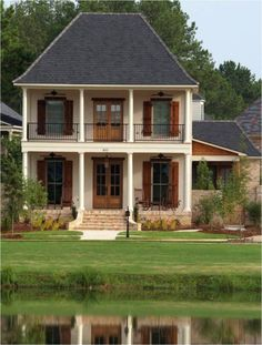Double doors, simple windows, shutters and a porch