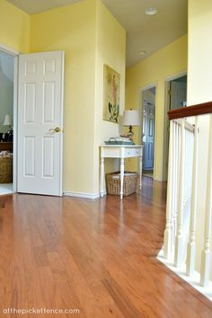 From plush green carpet to sleek wood floors, this landing area got a dramatic makeover! || @meetuatthefence