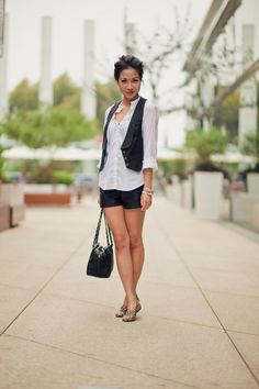 Short vest, longer shirt, short shorts. This works really well with flats.