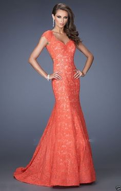 Pretty Coral lace mermaid dress with low back. Great for a prom, pageant, or bridesmaid