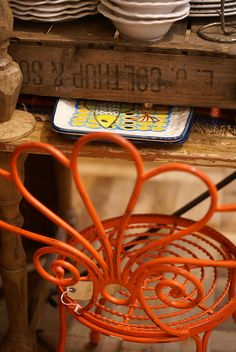 orange chair.  Lovely. - like the orange enamel metal with the old wood