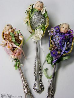 Miniature (fairy?) babies in spoons - detailed work (love the bling on the purple one!) - so whimsical - from the GALLERY II of Stephanie Blythe