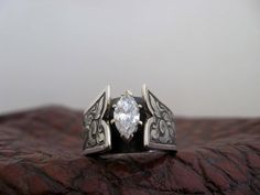 Custom made western wedding rings by Travis Stringer. Contact us on FaceBook. (Ring #107)