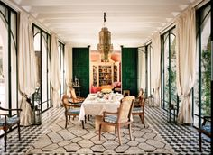 moroccan rugs, breezy drapes, blockprint fabrics and pale pink walls