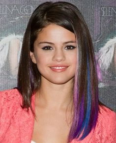 Selena Gomez with her pretty hair color streaks as seen on TeenVogue.com