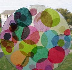 Circle Sun Catcher out of clear contact paper and tissue paper circles...We could do this with all of the shapes.