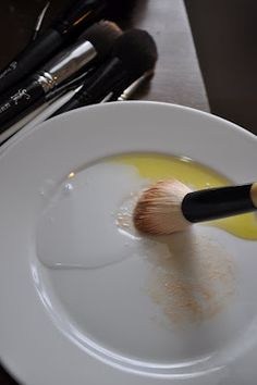 Clean makeup brushes with olive oil and dish soap...