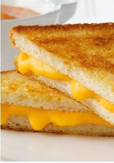 America's Favorite Grilled Cheese Sandwich –An easy and basic lunchtime recipe—nothing but bread, butter and cheese, grilled to golden perfection.