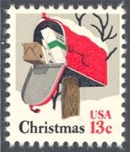 1977_10_21 $.13 A rural mailbox stuffed with Christmas packages and covered with snow is depicted on this contemporary Christmas stamp. The stamp was designed by Dolli Tingle.
