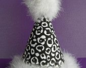 Black and white Animal print birthday party hat with white boa trim.  Made by GK Babies on etsy.com