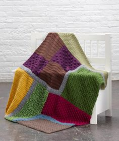 Practice different stitches with this crochet afghan made with Vanna's Choice inspired by aerial views of landscapes.
