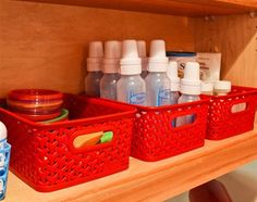 Such a great idea for a kitchen cabinet of baby stuff. The diaper attachment on
