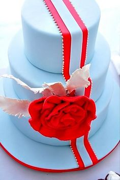 turquoise cake with red accents