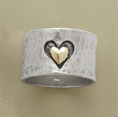 """Marrying precious metals and textures, a heart hand cast into our 1/2"""" wide hammered sterling silver band frames another of smoothly finished 14kt gold. A Sundance exclusive in whole and half sizes 5 to 9-1/2."""