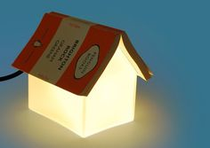 The Book Rest Lamp is the perfect little home for your sleepy book. Made of frosted glass, it gives off a soft light that's ideal for reading, but it also doubles as a book rest to ensure that you never lose your page