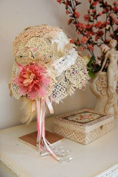 Vintage doiley covered hat and hand made flower. Created at Roos Textile Crafts Group. craft, hat