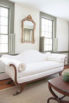 My Great Great Grandmother's Duncan Phyfe sofa was reupholstered in white organic duck cloth. Over the original horsehair and burlap,all ne...
