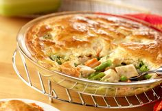 "Cream of chicken soup, frozen veggies, canned chicken and a biscuit crust put the ""easy"" in this delectable chicken pot pie.  It's so tasty, it just might become your go-to recipe."