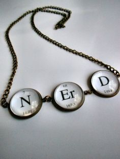 """""""Nitrogen! Erbium! Deuterium!    Show off both your love of science and your love of being a nerd with this simplistic glass topped necklace!"""""""