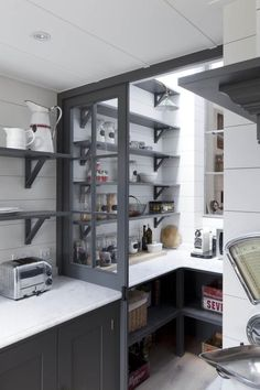 Pantry in Gray and white London kitchen renovation, open shelving inspired by French bistros, Remodelista