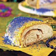 Traditional King Cake | Similar to coffee cake, this ring-shaped confection is as rich in tradition and history as it is in color and taste. | SouthernLiving.com